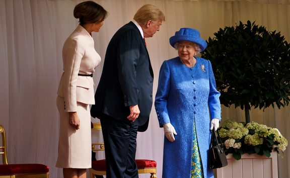 US President Donald Trump speaks with Queen Elizabeth II as US First Lady Melania Trump looks on at Windsor Castle.