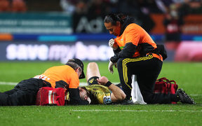 Hurricanes centre Wes Goosen gets medical attention after a tackle from Chiefs second five Johnny Fa'auli on 13 July, 2018.