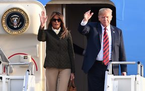 US President Donald Trump waves as he disembarks Air Force One with US First Lady Melania Trump at Prestwick Airport, south of Glasgow on 13 July, 2018.