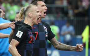 Croatia's Domagoj Vida celebrates with Mario Mandzukic after the FIFA World Cup Semi Final match between England and Croatia.