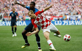 France's midfielder Paul Pogba and Croatia's defender Ivan Strinic vie for the ball during the Russia 2018 World Cup final football match between France and Croatia at the Luzhniki Stadium in Moscow.