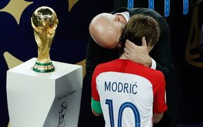 FIFA president Gianni Infantino speaks with Croatia's midfielder Luka Modric after the Russia 2018 World Cup final football match between France and Croatia in Moscow.