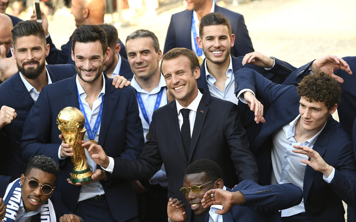 France's Olivier Giroud, Hugo Lloris, French president Emmanuel Macron, France's Paul Pogba, Benjamin Pavard and other teammates at a reception for the French national football team after they won the Russia 2018 World Cup.