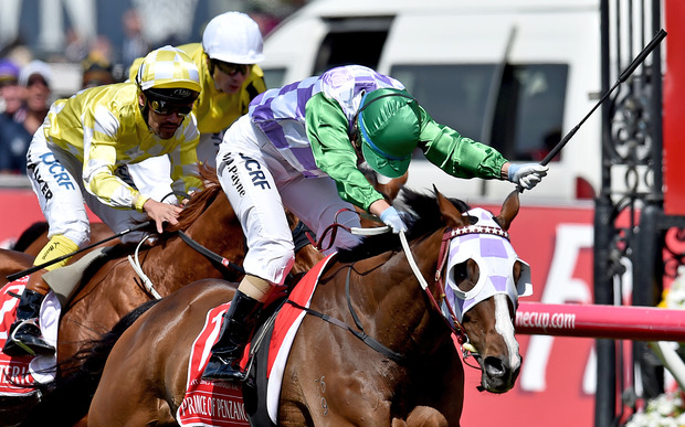 Jockey Michelle Payne riding Prince Of Penzance crosses the finish line to win the Melbourne Cup race at Flemington Racecourse in Melbourne, on Tuesday, Nov. 3, 2015.