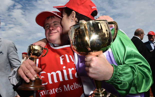 Steven (left) and Michelle Payne celebrate after Michelle rode Prince of Penzance to victory in the Melbourne Cup at Flemington Racecourse in Melbourne, Tuesday, Nov. 3, 2015.