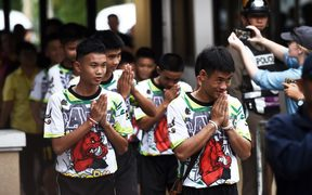 Some of the twelve Thai boys, rescued from a flooded cave after being trapped, arrive to attend a press conference in Chiang Rai , following their discharge from the hospital.