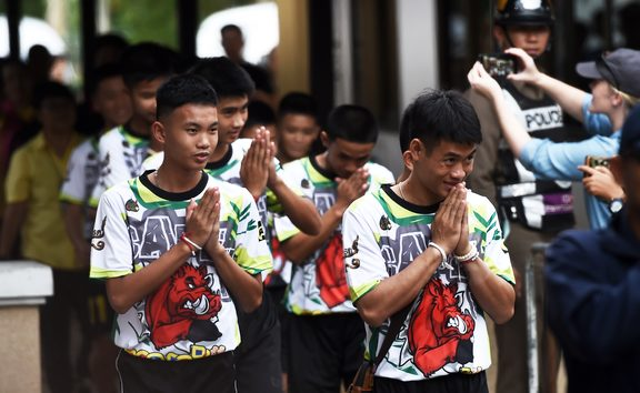 Some of the twelve Thai boys, rescued from a flooded cave after being trapped, arrive to attend a press conference in Chiang Rai on July 18, 2018, following their discharge from the hospital.