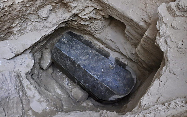 Mysterious Black Sarcophagus Finally Opened