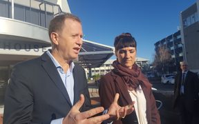 Greenpeace NZ executive director Russel Norman and volunteer Sara Howell outside Napier District Court 20 July 2018,