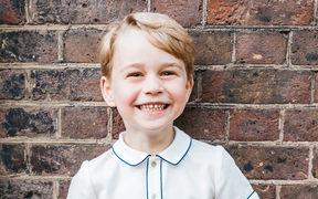 A handout picture released by Kensington Palace to mark Prince George's fifth birthday shows him smiling to camera.