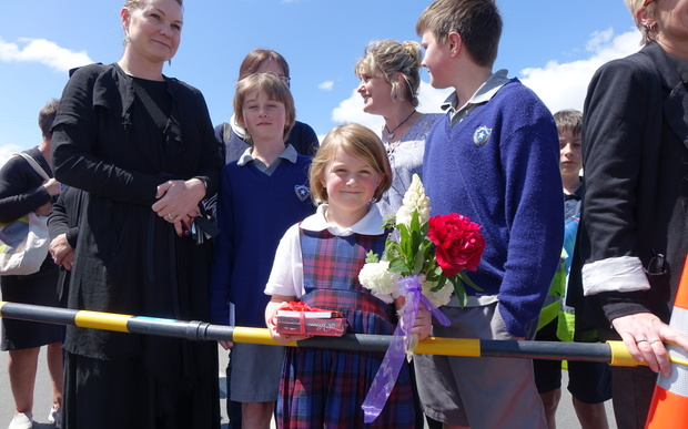 Five-year-old Saffron Chisholm, from St Mary's School in Mosgiel, presented the royal couple with a bouquet of flowers, a crossword book and a box of chocolates.