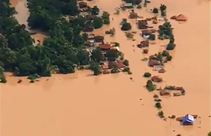 This screen grab taken on handout video footage from ABC Laos on July 24, 2018 shows an aerial view of the flooded plains in Attapeu province after a dam collapsed the day before.