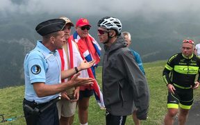 Chris Froome was mistaken by police for a fan, Froome's wife said.