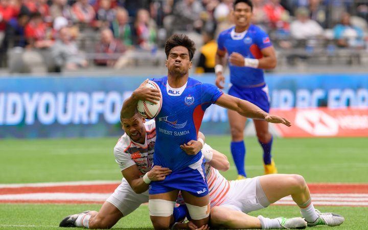 Gordon Langkilde is tackled during the Vancouver Sevens in March.
