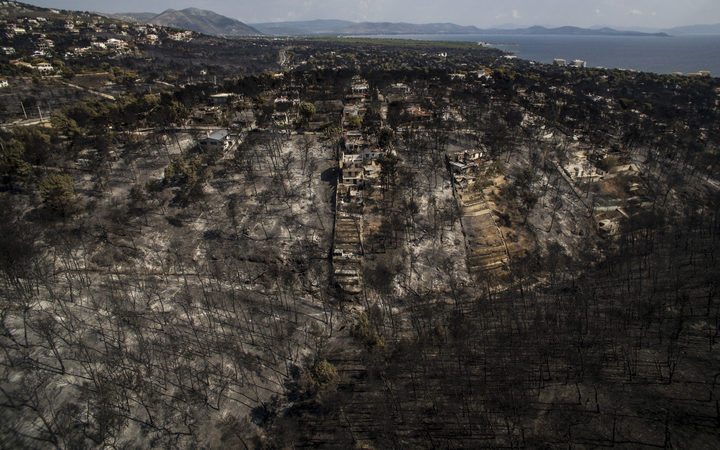 Bodies found clasped in hugs as Greek wildfires kill at least 50