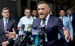 Conor McGregor talks to the press after he pleaded guilty to a single violation of disorderly conduct, in Brooklyn Criminal Court.