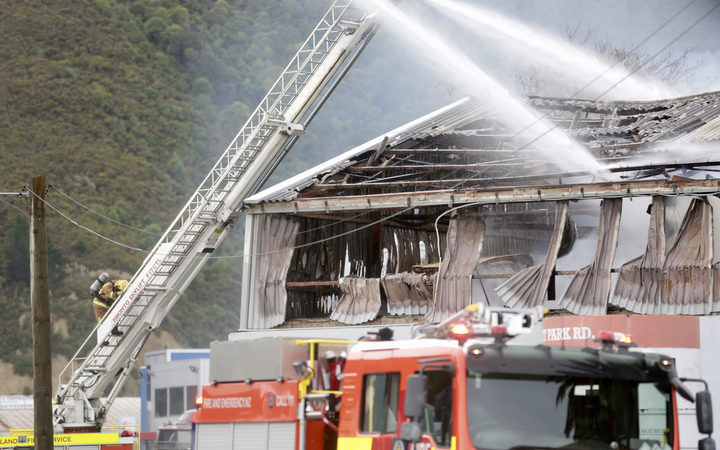 Firefighters tackling a large blaze in a commercial building in the Lower Hutt suburb of Gracefield.