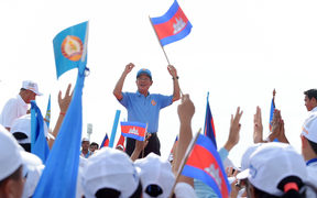 Cambodia's Prime Minister Hun Sen and leader of the ruling Cambodian People's Party (CPP) waves to supporters.