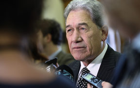 Winston Peters speaks to the media as acting Prime Minister