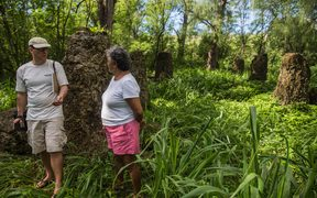 Earthjustice lawyer David Henkin (left) and Deb Fleming, a Tinian resident at Masalok, an ancient Marianas cultural site where local residents gather plants for subsistence and traditional medicine.  Proposed US military training would prevent access to this site much of the year.