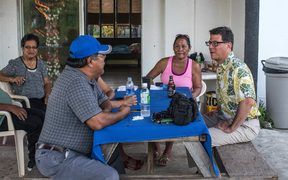 David Henkin (right) meets with Tinian residents concerned about proposed US military training on their island.