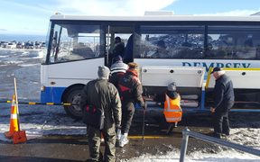 Snow seekers getting on replacement buses.