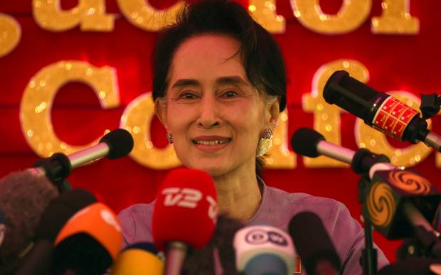 Myanmar opposition leader Aung San Suu Kyi and head of the National League for Democracy (NLD) speaks at a press conference from her residential compound in Yangon