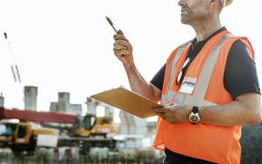 Man in high vis gear at building site.Architecture, Construction Safety, First Concept image.
