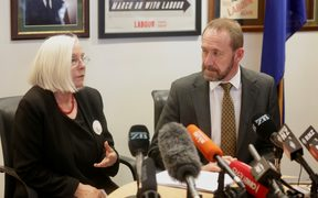 Justice Minister Andrew Little with Rosslyn Noonan.