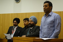 Jaswinder Singh (right) and Satnam Singh (second from left), with two interpreters, at the High Court in Nelson on Monday 9 November.