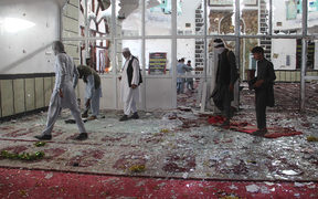 Afghan residents walk inside a damaged mosque after a suicide attack during Friday prayers in Gardez of Paktia province.