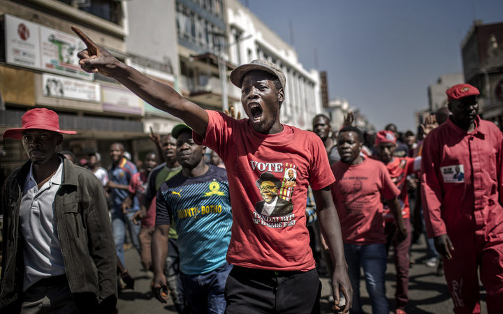 Supporters of the opposition party Movement for Democratic Change (MDC), protest against alleged widespread fraud by the election authority and ruling party, after the announcement of election's results, in the streets of Harare.