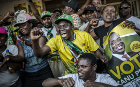 Supporters of the newly reelected Zimbabwe President Emmerson Mnangagwa, celebrate in Mbare, a district of the Zimbabwe's capital Harare.