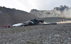 Twenty people are confirmed dead after a vintage World War II aircraft crashed into a Swiss mountainside, police reports said.