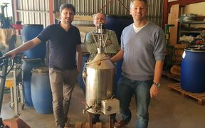Michael Oelgemöller from James Cook University (right) at a distillery in New Caledonia.