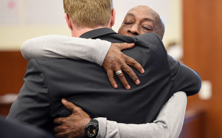 Plaintiff DeWayne Johnson hugs one of his lawyers after hearing the verdict to his case against Monsanto at the Superior Court Of California in San Francisco, California.