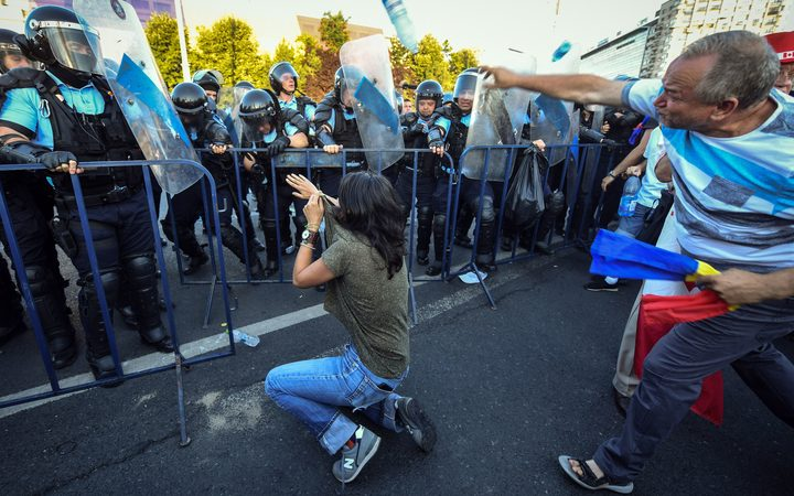 Romanian Anti Riot Police Clash With Protesters Throwing Plastic Bottles At Them During A Demonstration In