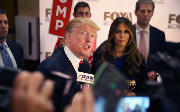 Donald Trump and his wife Melania speak to media after a Republican presidential debate.