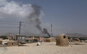 US forces launched airstrikes on August 10 to counter a major Taliban assault on an Afghan provincial capital, where terrified residents cowered in their homes amid explosions and gunfire as security forces fought to beat the insurgents back.