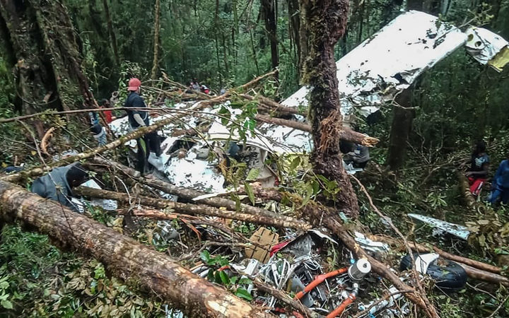 The crash site of a Swiss-made Pilatus aircraft at Menuk mountain in Oksibil.