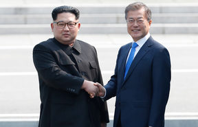 North Korea's leader Kim Jong Un shakes hands with South Korea's President Moon Jae-in at the Military Demarcation Line.