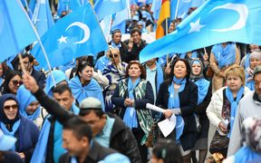 "Ethnic Uighurs took part in a protest march in Brussels asking for the EU to call upon China to respect human rights in the Chinese Xinjiang region and asking for the closure of ""re-education center"" where some Uighurs are detained."