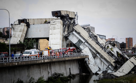 Rescue workers on a part of a Morandi motorway bridge after a section collapsed earlier in Genoa.