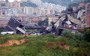 Rescuers scouring through the wreckage after part of a viaduct of the A10 freeway collapsed.