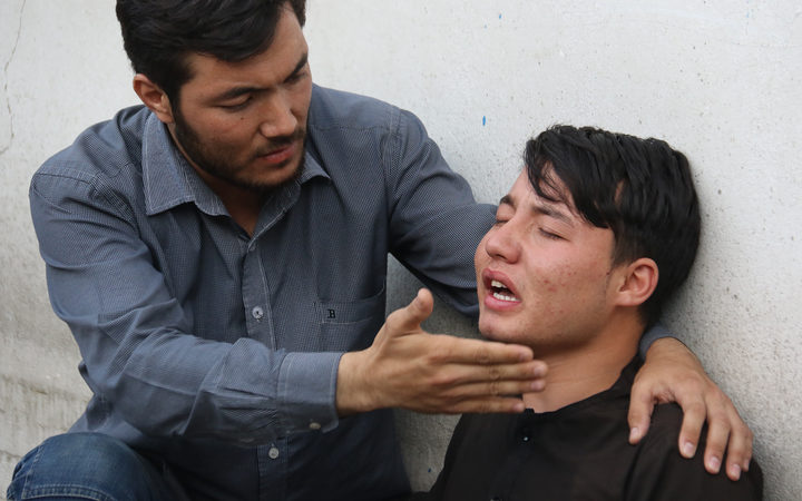 An Afghan resident cries for his relative following a suicide attack in Kabul.