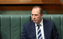Australian Immigration Minister Peter Dutton reacts during House of Representatives Question Time at Parliament House in Canberra, Monday, Nov. 9, 2015.
