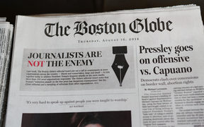 "Hundreds of U.S. newspapers joined together and published editorials decrying President Donald Trump's description of the media as the ""enemy of the people."""