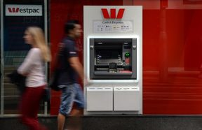 People walk past a Westpac ATM in Sydney