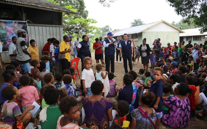 The WHO in PNG speaking to the community in Lae