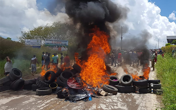 Residents of the Brazilian border town of Pacaraima burn tyres and belongings of Venezuelans immigrants after attacking their two main makeshift camps, leading them to cross the border back into their home country.